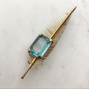 Vintage gold feather pin blue stone